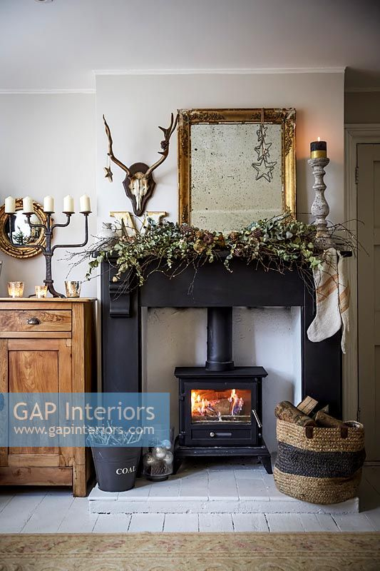 Country living room with fireplace decorated for Christmas