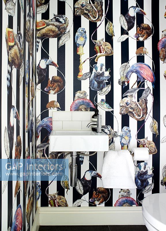 Colourful wallpaper on feature wall in modern bathroom