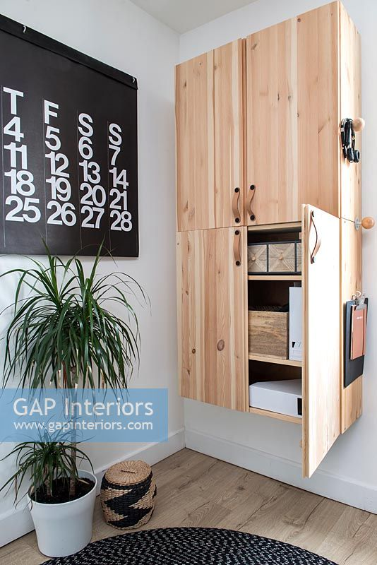 Wall mounted wooden cabinet and modern artwork calendar