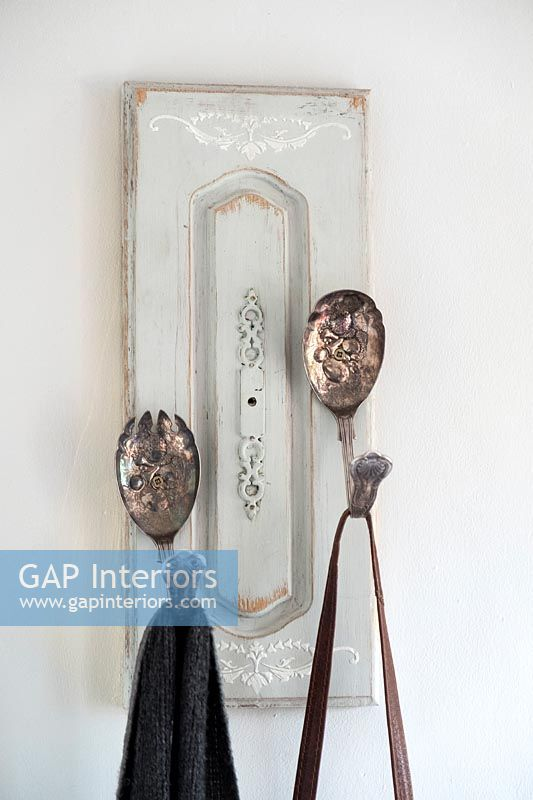 Coat hooks made from old wooden door panel and cutlery