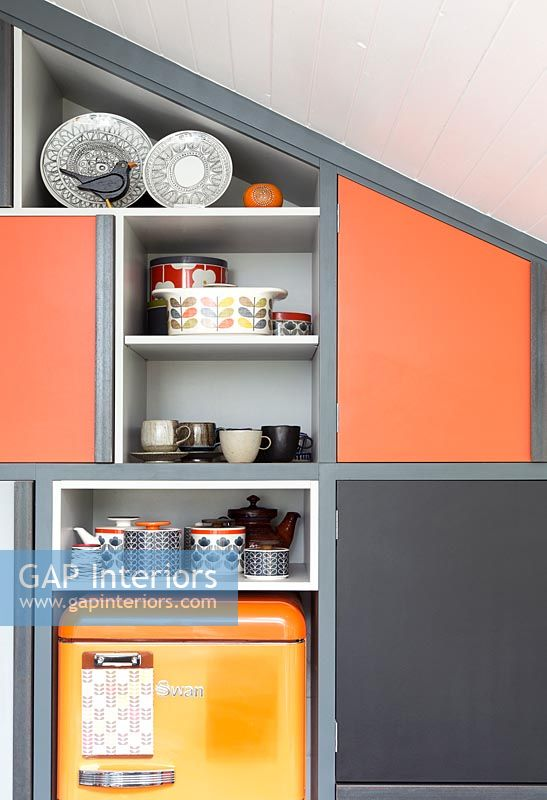 Built-in cabinets and shelve with different coloured doors