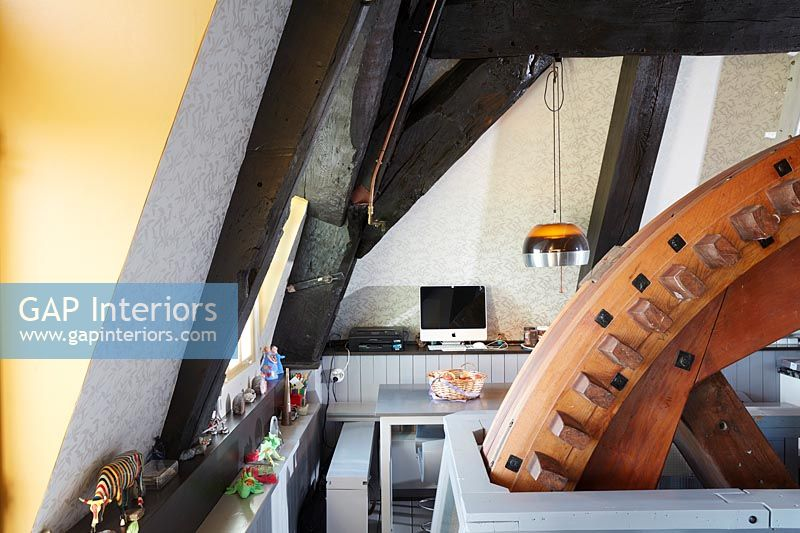 Modern computer and desk in converted C16th Dutch Windmill