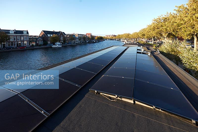 Modern houseboat roof with solar panels