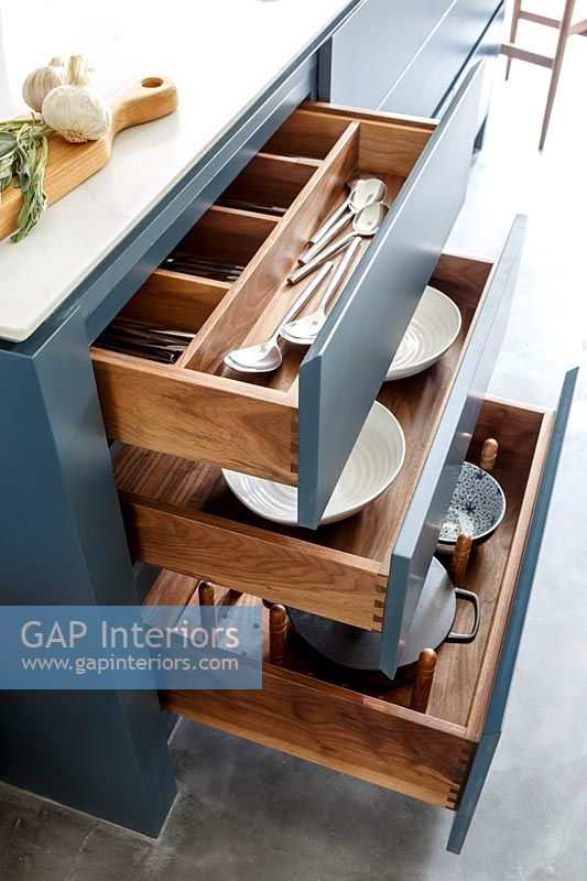 Open drawers in modern kitchen island