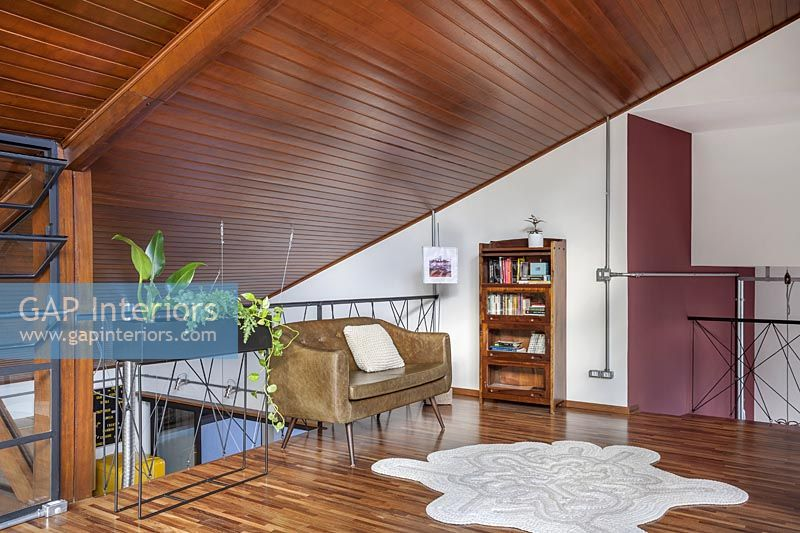 Modern living room with pitched wooden ceiling