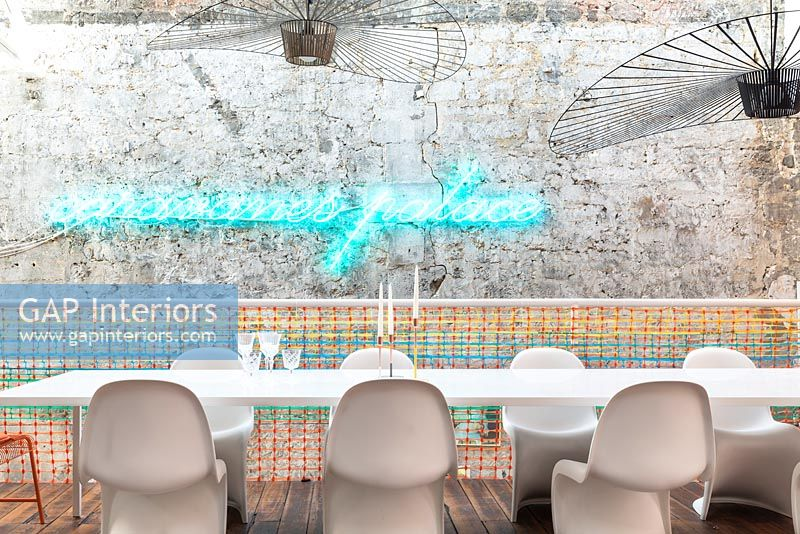 Illuminated neon artwork on contemporary dining room wall