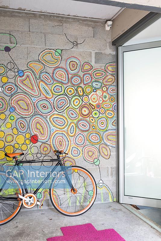 Colourful mural on hallway wall with bicycle