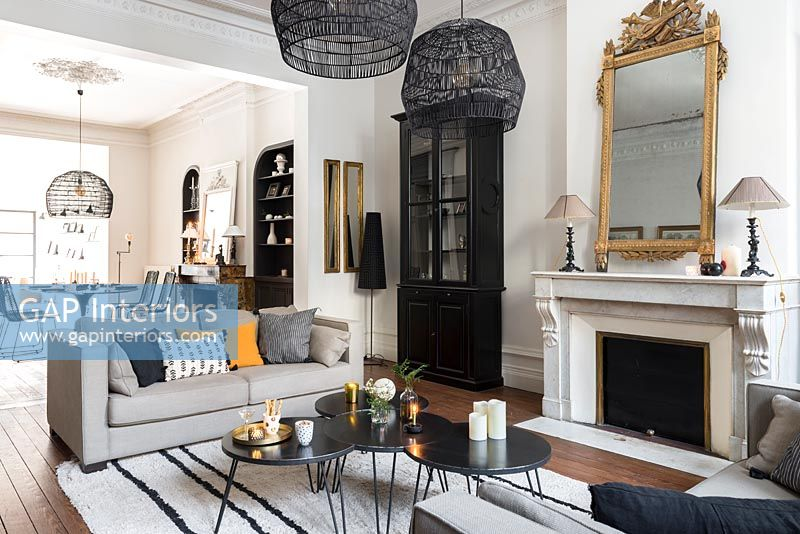 Modern monochrome living room with period details and view to dining table