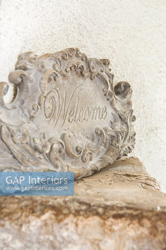Carved stone welcome plaque