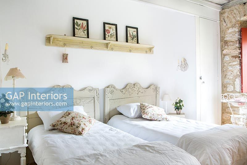 Twin beds in country bedroom