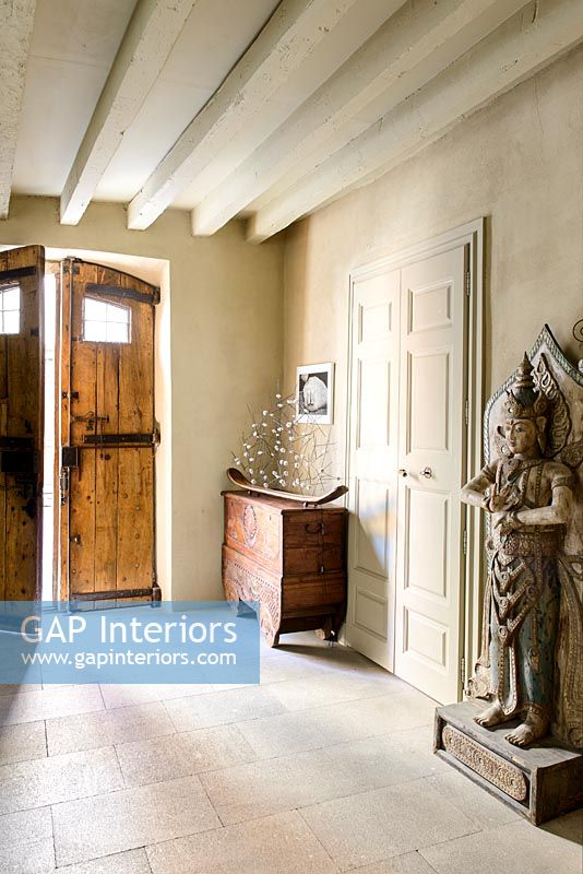 Large wooden carved sculpture in classic hallway