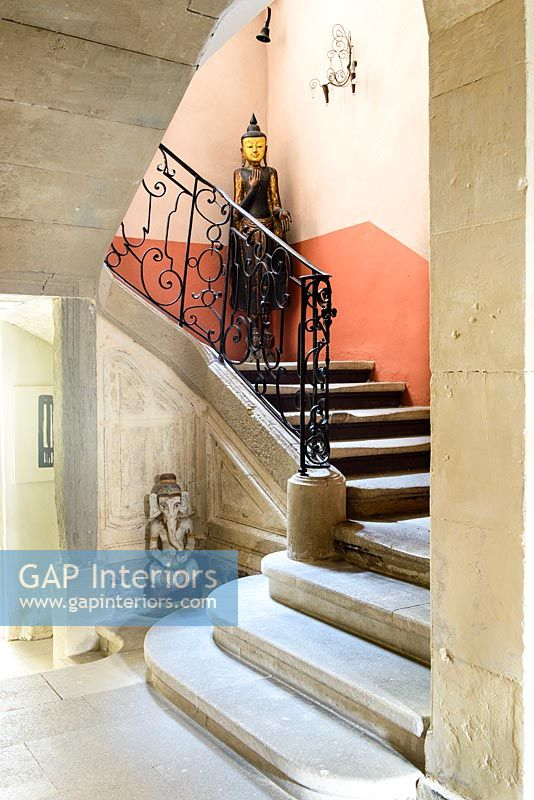Stone steps and sculptures in classic hallway
