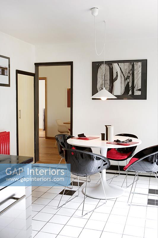 Black, white and red dining area in modern kitchen-diner