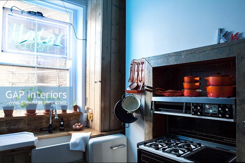 Small vintage kitchen with cooker in fireplace alcove