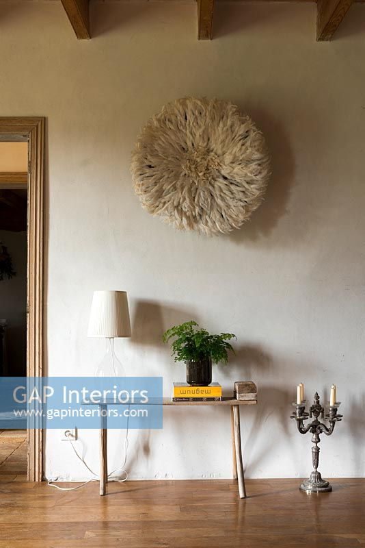 Textured circular wall hanging and small side table