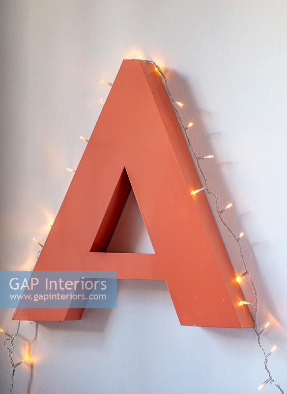 Large orange letter A with fairlights