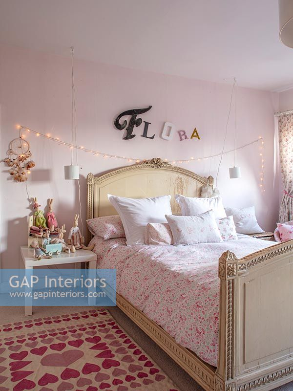 Childrens room with name in lettering and fairy lights over bed