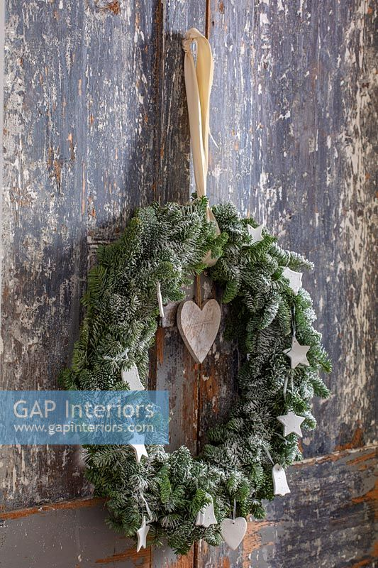 Detail of Christmas wreath on distressed wooden doors