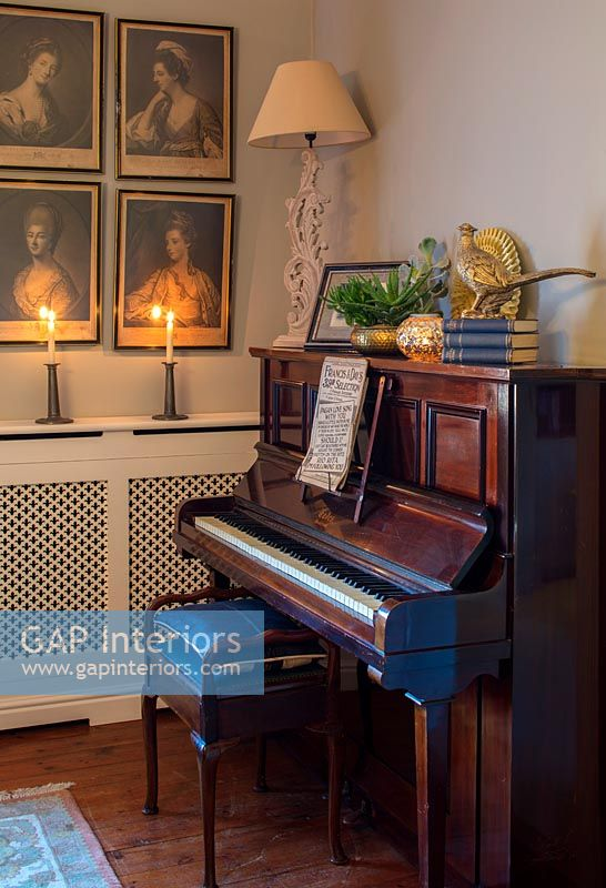 Upright piano in classic dining room