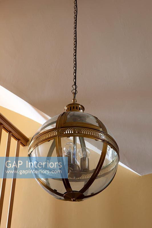 Gilt and glass orb lantern