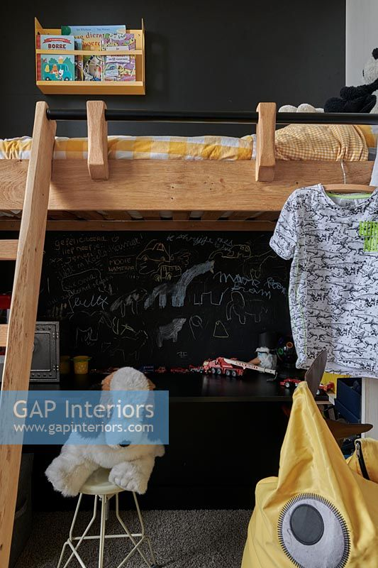 Blackboard wall and loft bed in childrens bedroom