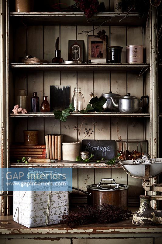 Wooden dresser in country kitchen with Christmas decorations