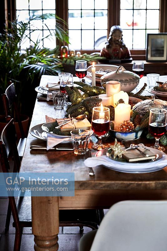 Country dining table laid for Christmas dinner