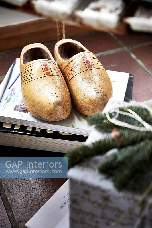 Close up Wooden clogs and Christmas gift