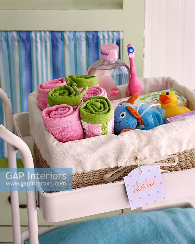 Basket of towels and bath toys and accessories for children