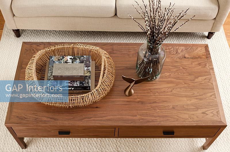Wooden coffee table with fish tail ornament and basket