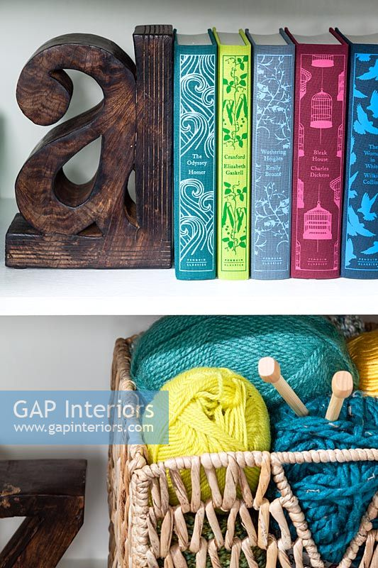 Items including colourful books on bookshelves