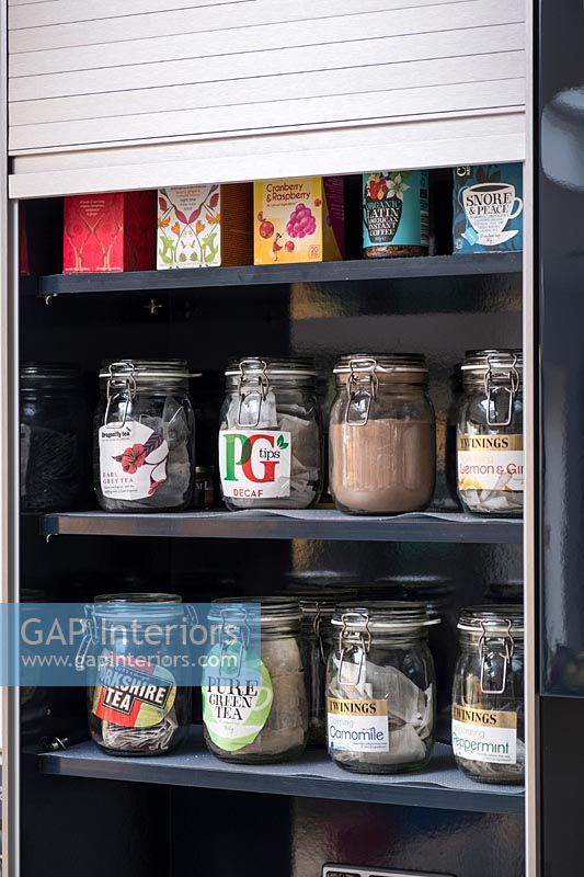 Kilner jars of tea on shelves