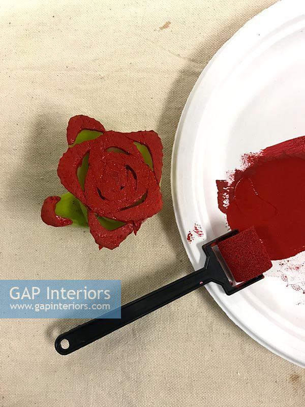 Celery rose cut out and covered with red paint to create a pattern stamp