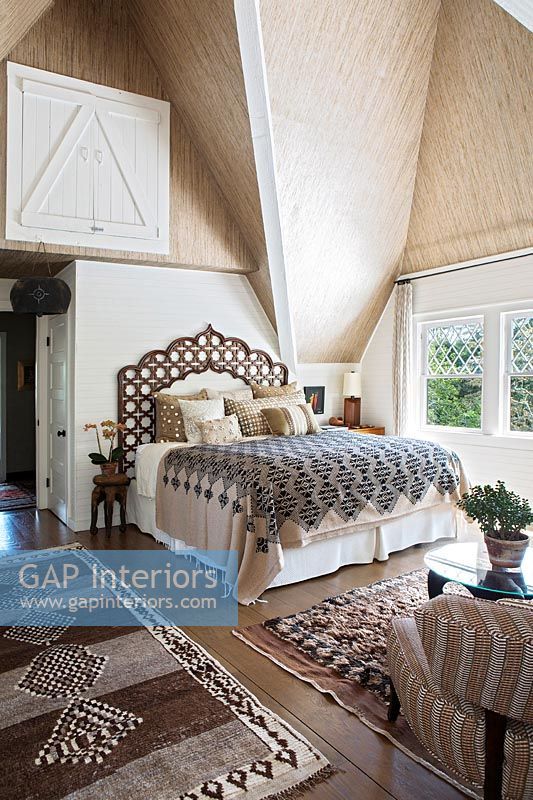 Country bedroom with vaulted ceiling