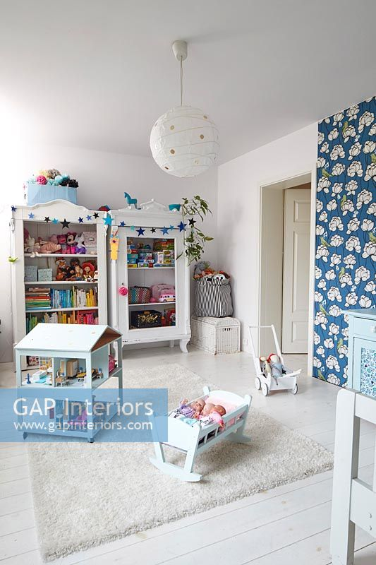 Childrens room with bold print wallpaper on feature wall