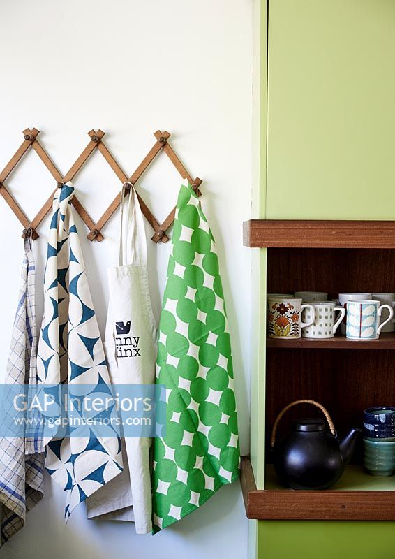 Tea towels and apron hung up in kitchen