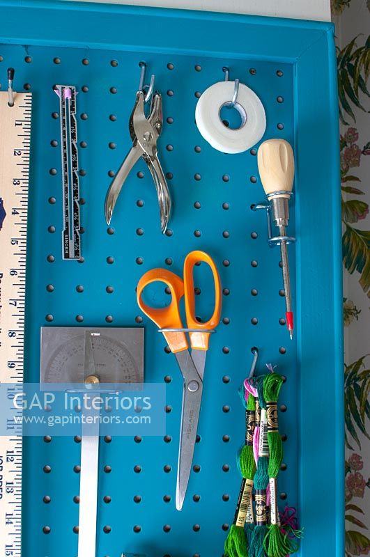 Space saving wall mounted organiser for tools and accessories