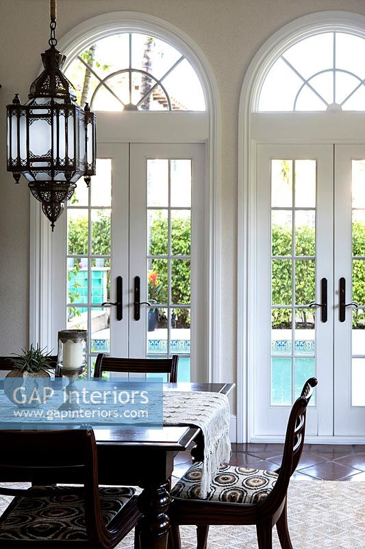 Classic dining room with view to swimming pool outside