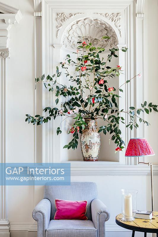 Flower arrangement in formal living room alcove
