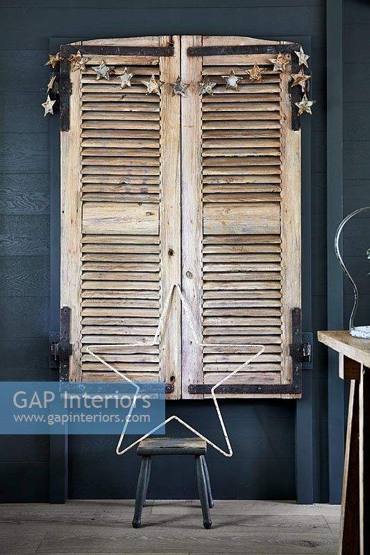 Wooden window shutters decorated with stars