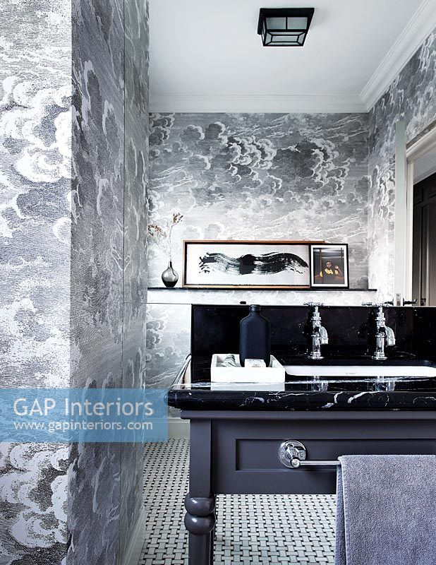 Grey storm cloud patterned wallpaper in classic bathroom