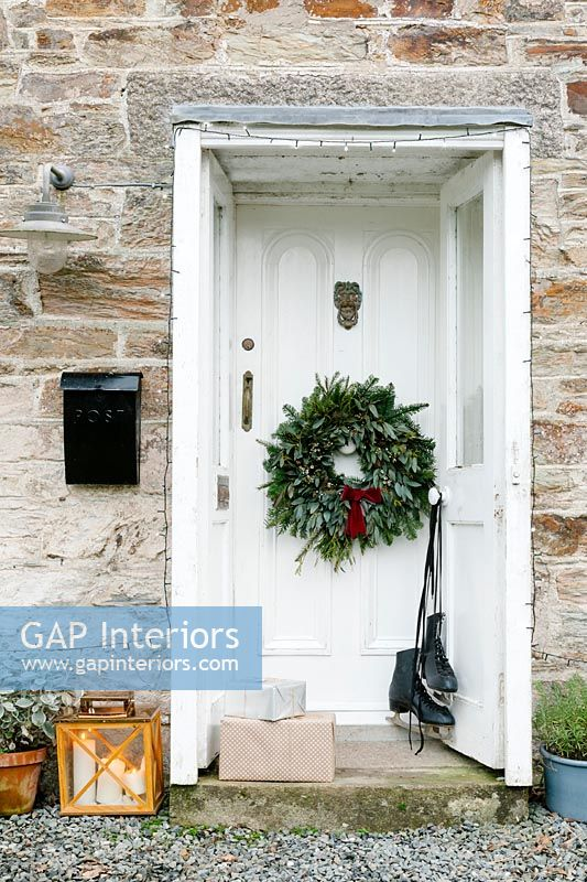 Cornish cottage doorway decorated for Christmas