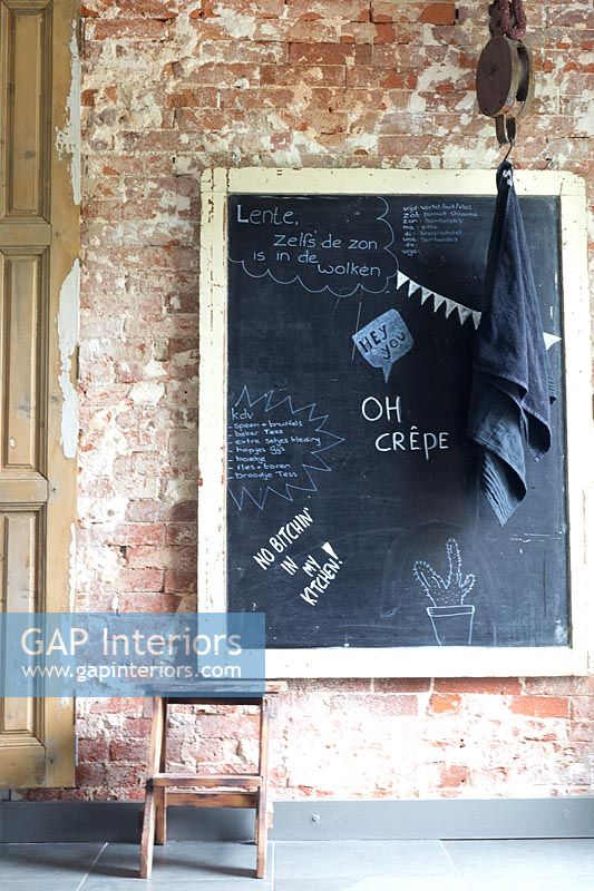 Chalk board on exposed brick wall