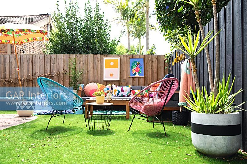 Colourful outdoor living area with artificial grass