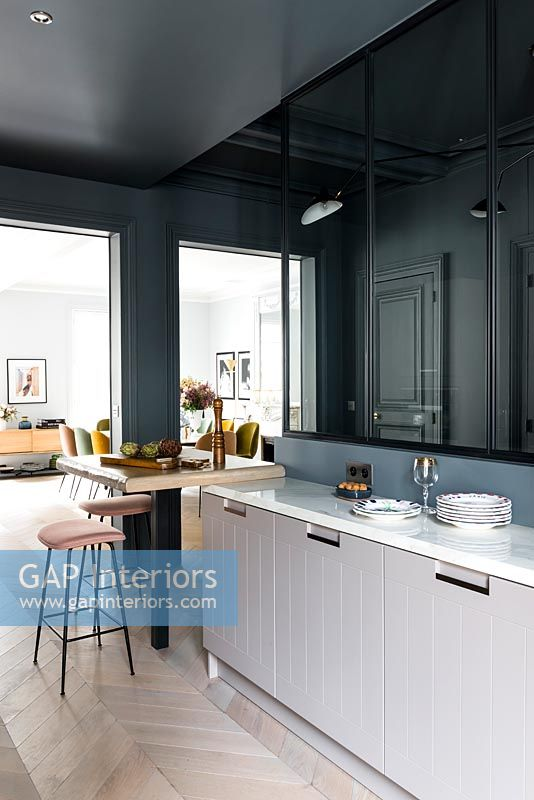 Modern kitchen with dark grey painted walls and parquet flooring