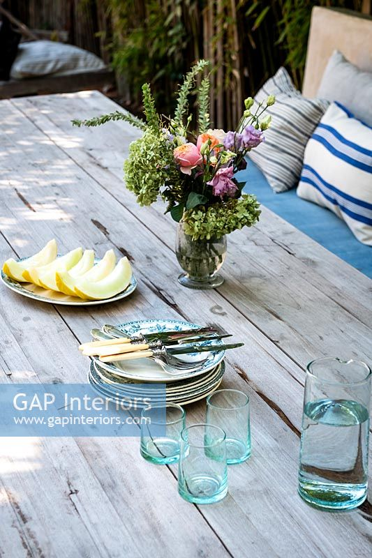 Plates and glasses on outdoor dining table