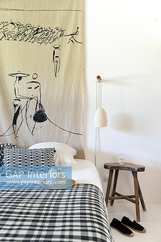 Painted wall hanging in black and white modern country bedroom