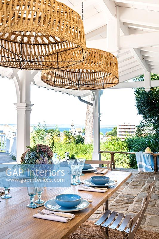 Outdoor dining area on covered terrace with sea views