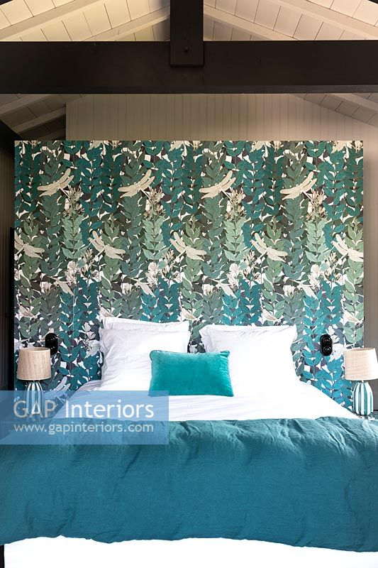 Decorative painted headboard in modern bedroom