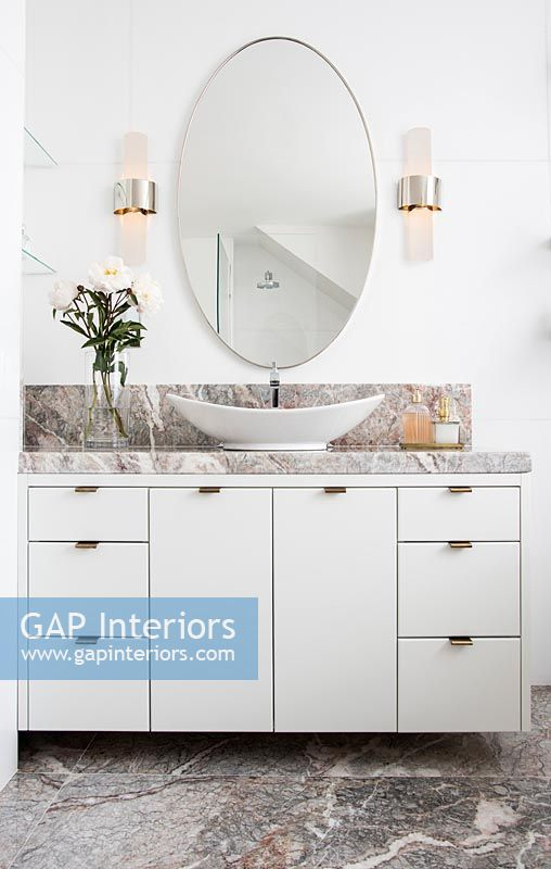 Sink unit in white bathroom with marble floor